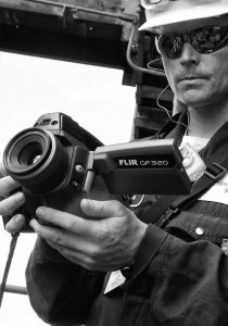 what is thermography image of man holding camera